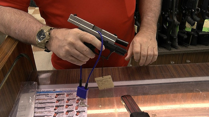 A trigger lock is displayed on a handgun at Discount Gun Mart, July 30, 2019.