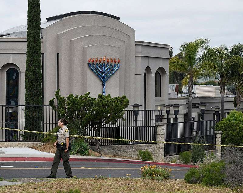 A San Diego county sheriff's deputy stands in front of the Chabad of Poway sy...