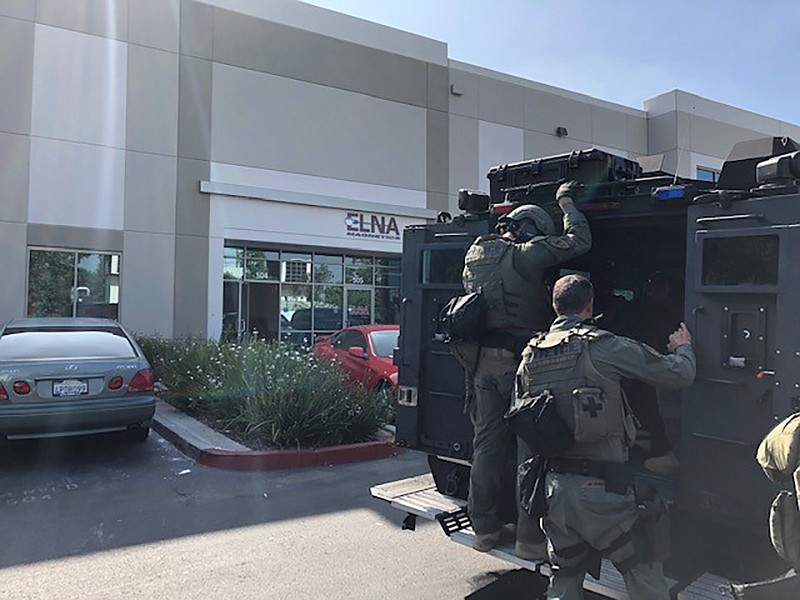 Chula Vista SWAT team at the front of the unlicensed marijuana dispensary on ...