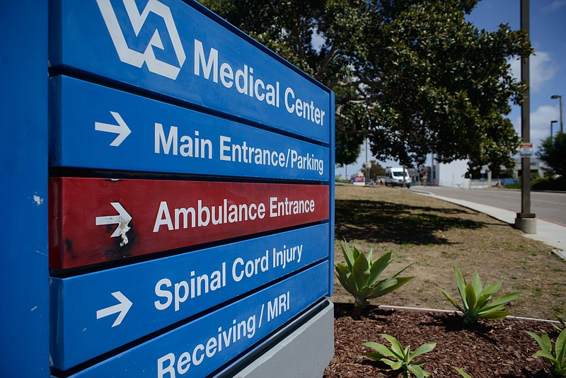 A sign outside the San Diego VA Medical Center directs visitors to the spinal...
