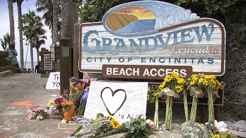 A makeshift memorial is erected for victims of the bluff collapse at Grandvie...