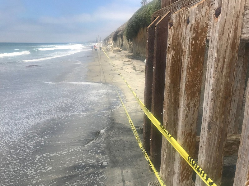 Police tape blocks off the section of beach in Encinitas where three women we...