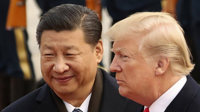 President Trump and Chinese President Xi Jinping participate in a welcome cer...