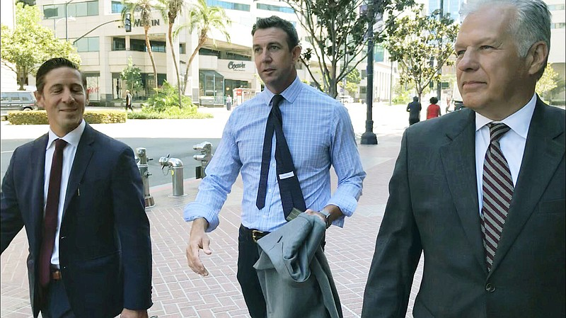Congressman Duncan Hunter (R-Alpine) leaves court Tuesday after a judge agree...
