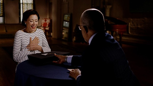 Host Henry Louis Gates, Jr. with journalist Ann Curry whi...