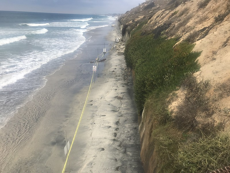 Police tape blocks off a section of beach in Encinitas where three women were...