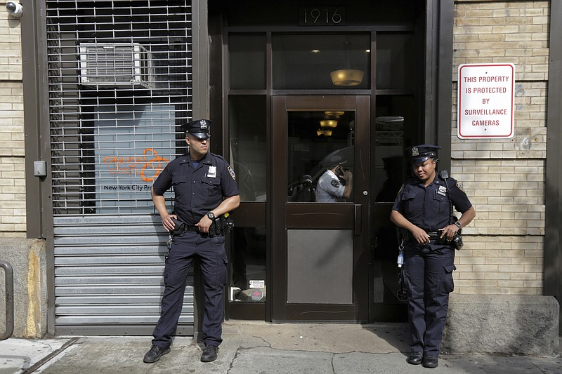 In this Thursday, June 21, 2018 file photo, police stand outside an office fo...
