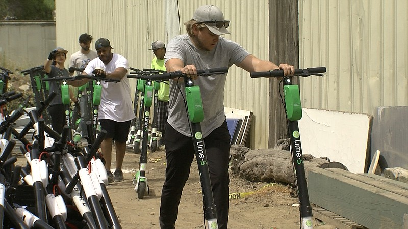 Lime employees gather scooters that were impounded during Comic-Con, July 22,...