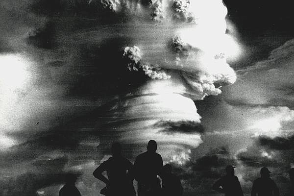 Observers watch an explosion during Operation Hardtack in 1958. 35 nuclear te...