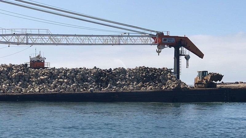 A mound of rocks slowly builds out an artificial reef off the San Clemente pi...