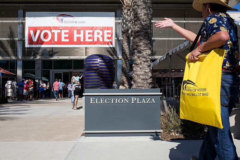 San Diego County residents are shown outside the Registrar of Voters Office i...