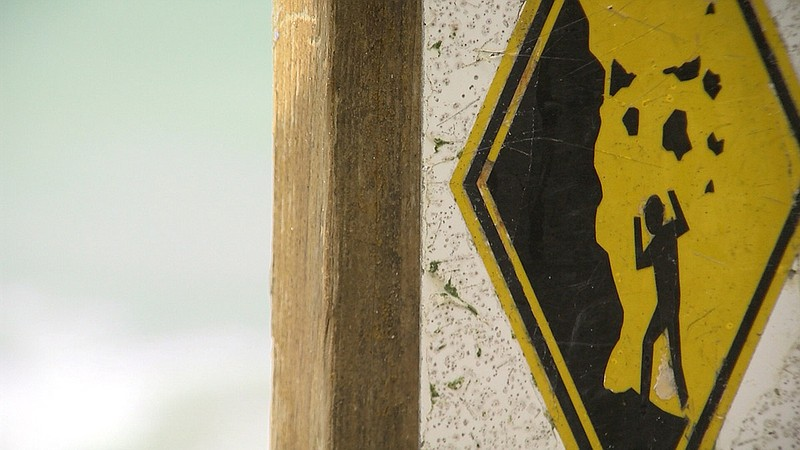 A sign warning beachgoers of the danger of bluff collapse at San Diego beache...