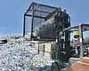 Plastic bottles pile up at the Miramar Recyclin...