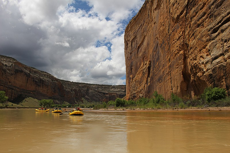 Rafters float past Steamboat Rock at the confluence of the Yampa and Green Ri...