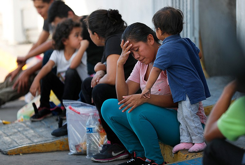 In this July 16, 2019, file photo, migrants wait at an immigration center on ...