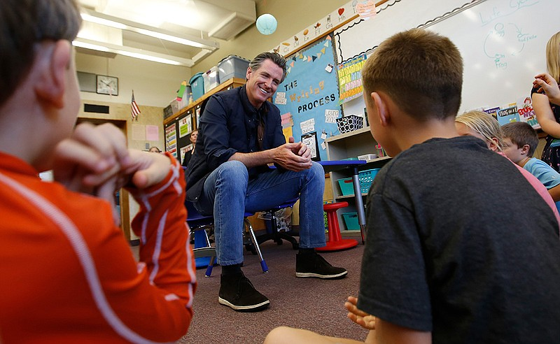 In this Aug. 21, 2019 file photo Gov. Gavin Newsom takes questions from secon...