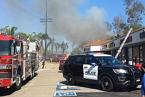 Photo for Burning Escondido Dry Cleaner's Roof Collapses, Injuring Firefighter