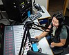 Vila Xiong operates the mixing board herself wh...