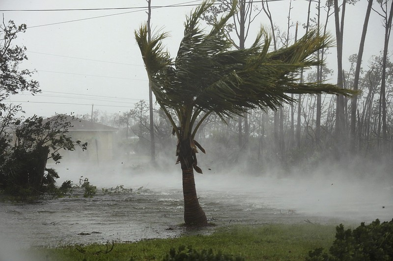 A road is flooded during the passing of Hurricane Dorian in Freeport, Grand B...
