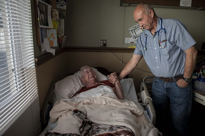 Dr. Dan Dahle visits his patient Wilma Chesbro, a former operating room nurse...