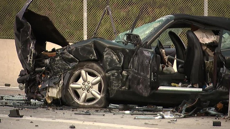 The wreckage of a fatal crash on the HOV off-ramp from southbound Interstate ...