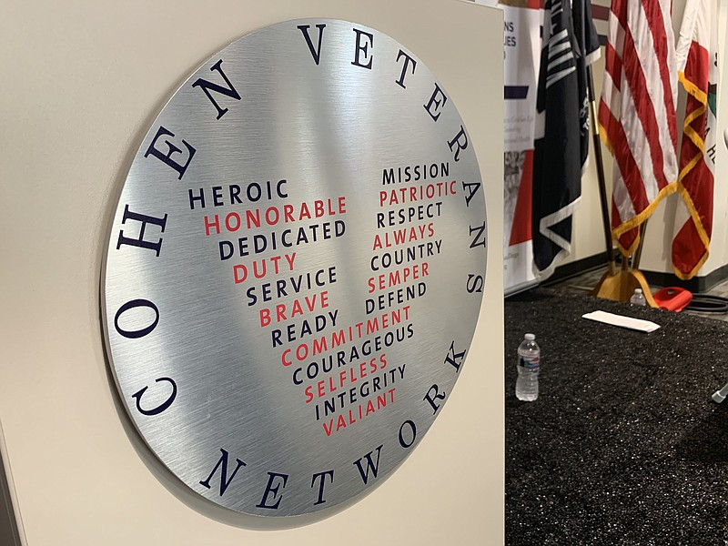 The Cohen Veterans Network logo appears on a podium at the Steven A. Cohen Mi...