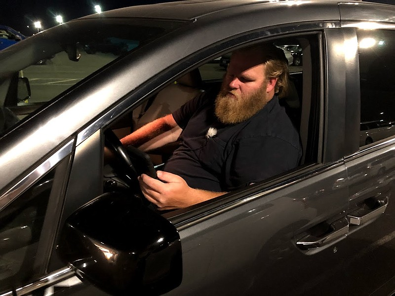Uber Driver Jeff Perry waits in the Sacramento International Airport cell pho...