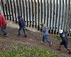 Central American migrants walk along the U.S. b...