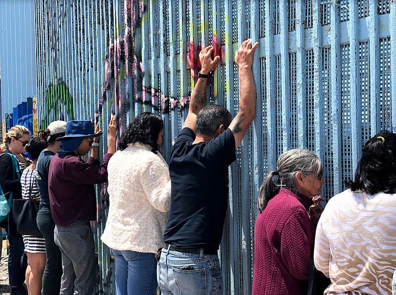 In this photo taken May 5, 2019, Border Church is underway, and people in Tij...