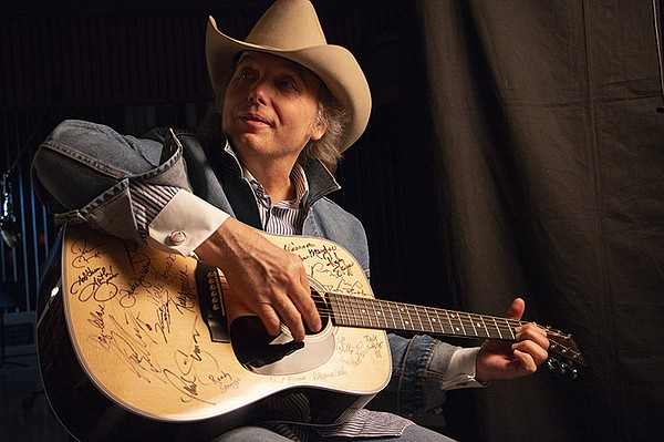 Dwight Yoakam signs Martin D-28 guitar. Yoakam is among t...