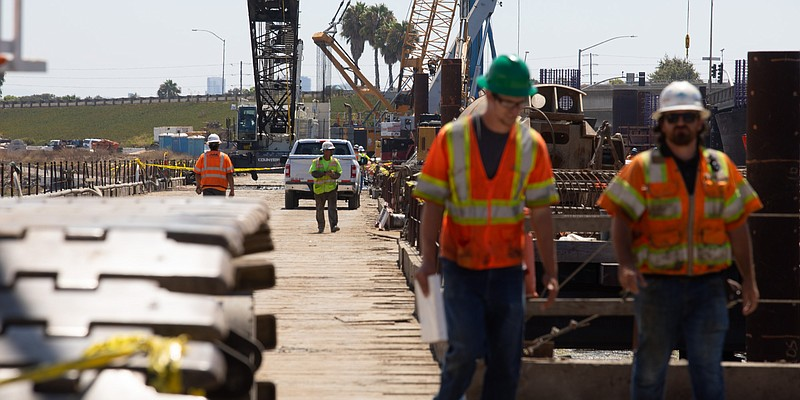 Construction crews work on the West Mission Bay Drive bridge, Aug. 26, 2019. ...