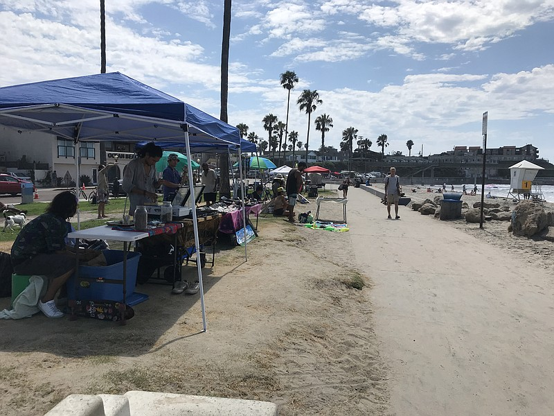 Street vendors line up on the pathway in front of Ocean Beach on September 4,...