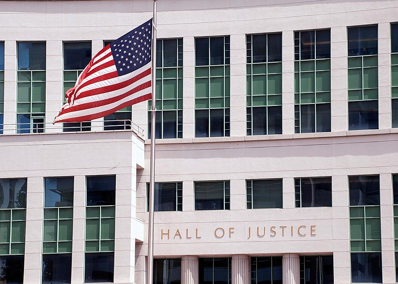 The U.S. flag waving in front of the Hall of Justice in downtown San Diego on...