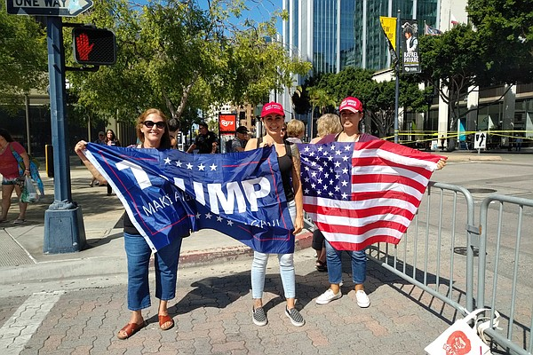 President Trump supporters hold up a banner in downtown S...