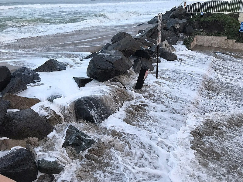 Waves wash over riprap along Cortez Avenue in Imperial Beach, Jan. 18, 2019.