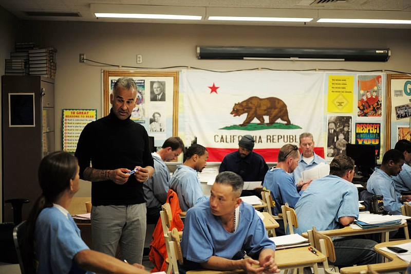 Bidhan Roy, a Cal State LA professor, teaches inmates participating in an und...
