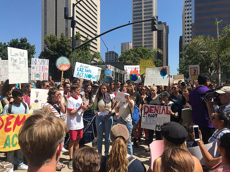San Diego high school students speak after walking out as part of the Global ...