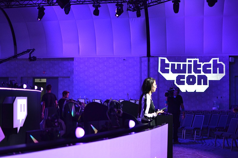 A Twitch host giving a behind-the-scenes look at TwitchCon on Sept. 26, 2019,...