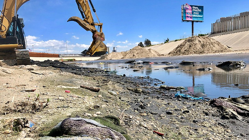Sewage flows through canal from Mexico near San Ysidro, March 28, 2019.