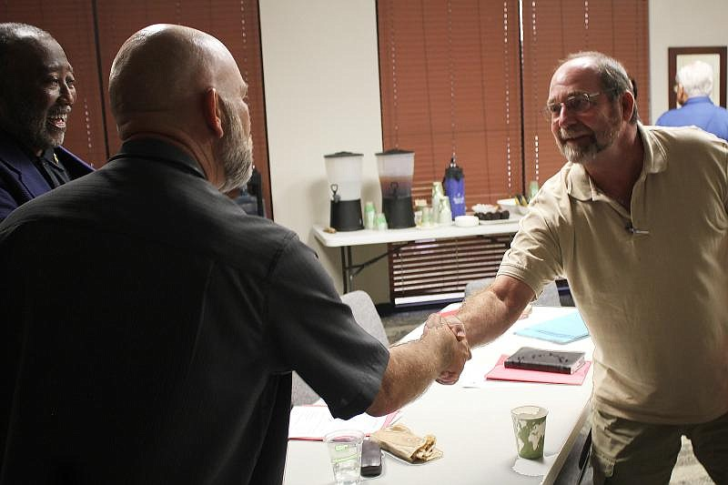 Mark George (right), a chaplain at the Caldwell County Jail in Lockhart, Tx.,...