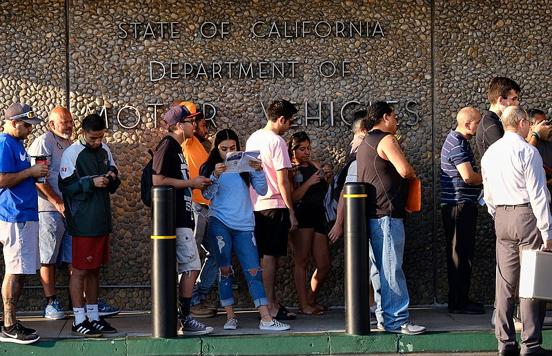 In this Aug. 7. 2018 file photo people line up at the California Department o...