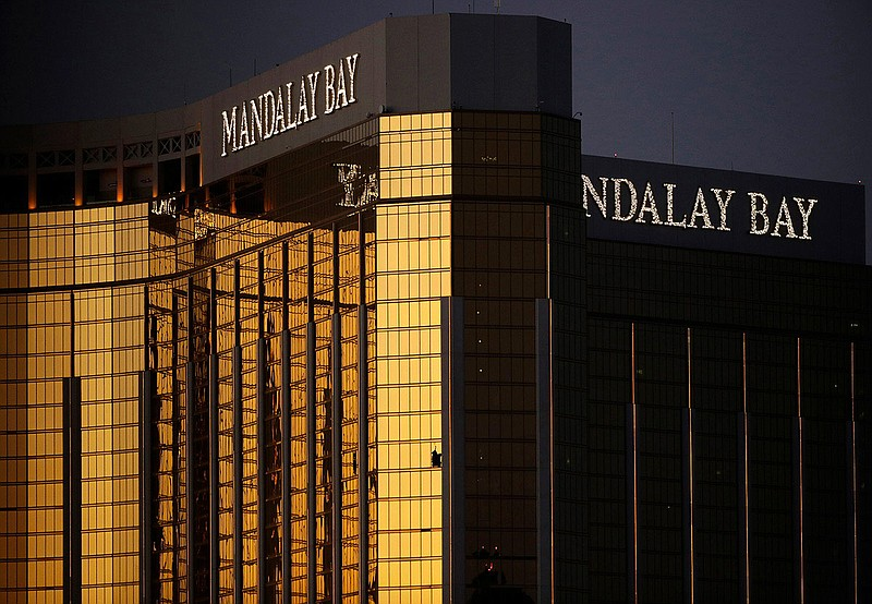 In this Oct. 3, 2017, file photo, windows are broken at the Mandalay Bay reso...