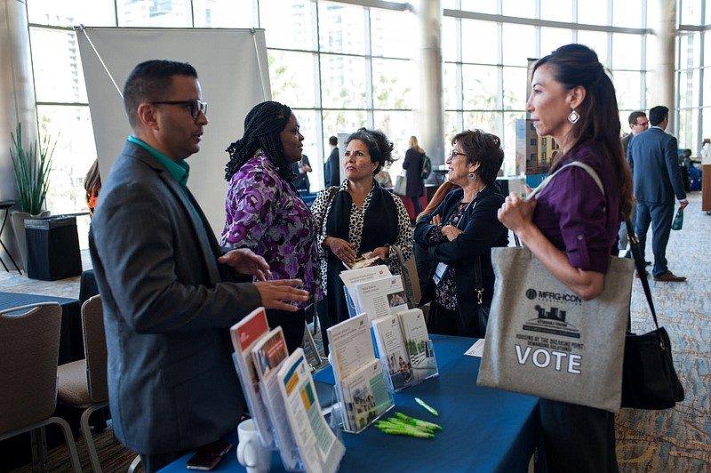 Attendees of a previous affordable housing conference put on by the San Diego...