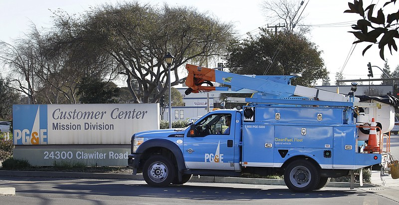 A Pacific Gas & Electric repair truck enters their customer center in Hayward...