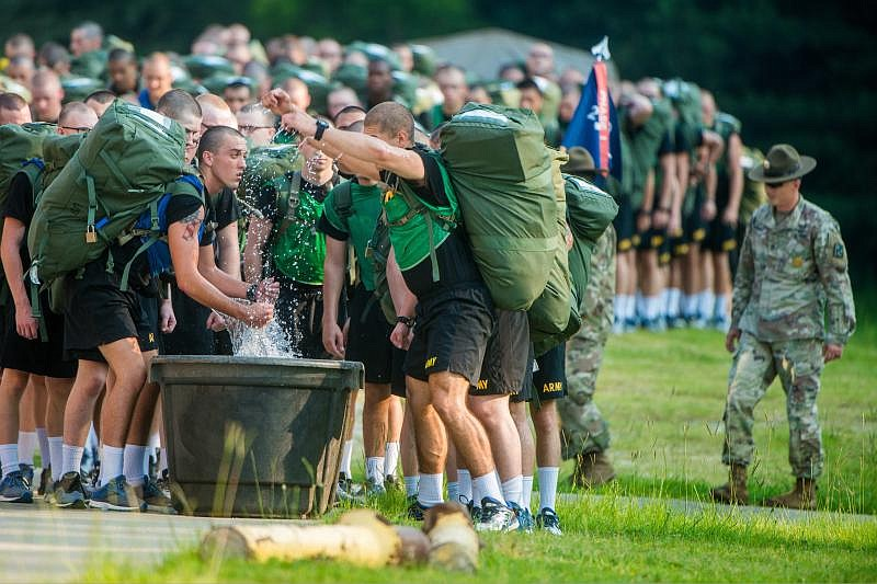 Soldiers at Fort Benning, Ga. use immersion troughs filled with ice and water...