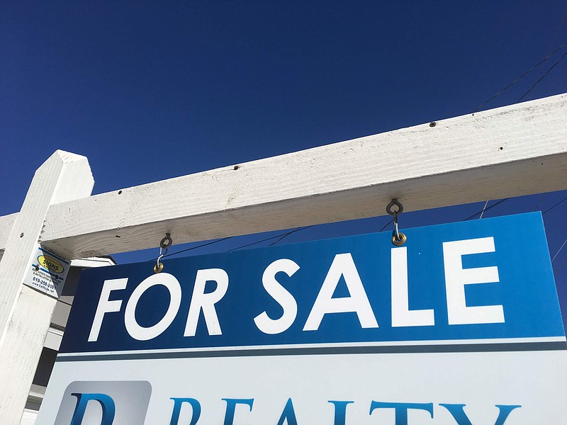 A 'For Sales' sign in front of a home in San Carlos in this undated photo.
