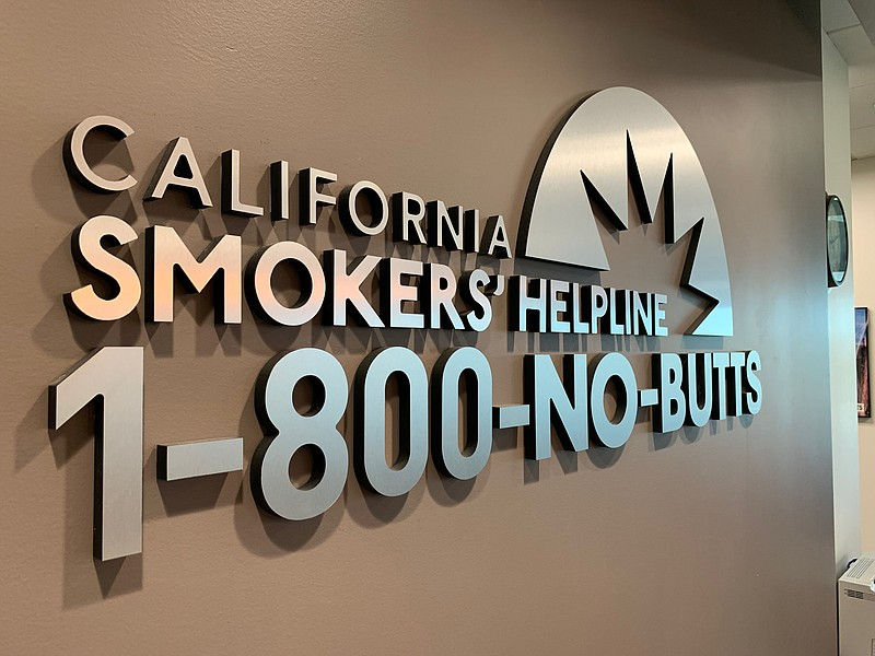 A sign for the California Smokers' Helpline and its phone number, 1-800-No-Bu...