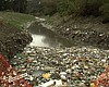Trash fills a binational waterway in the Tijuan...