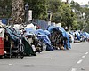 In this Sept. 19, 2017 photo, homeless people s...