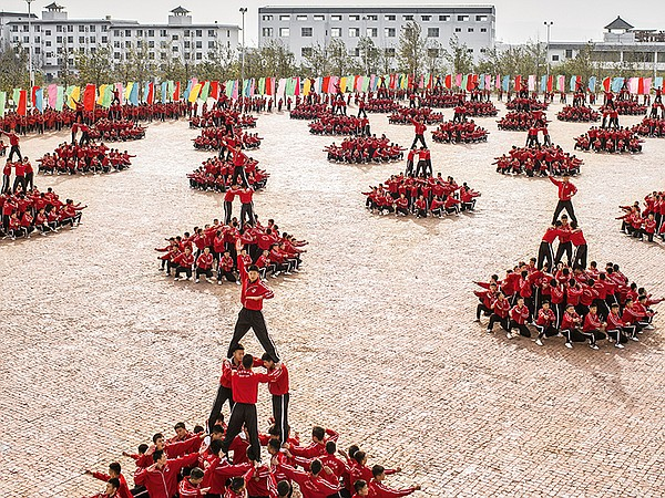 Shaolin Kung-Fu students put on a display of strength and...